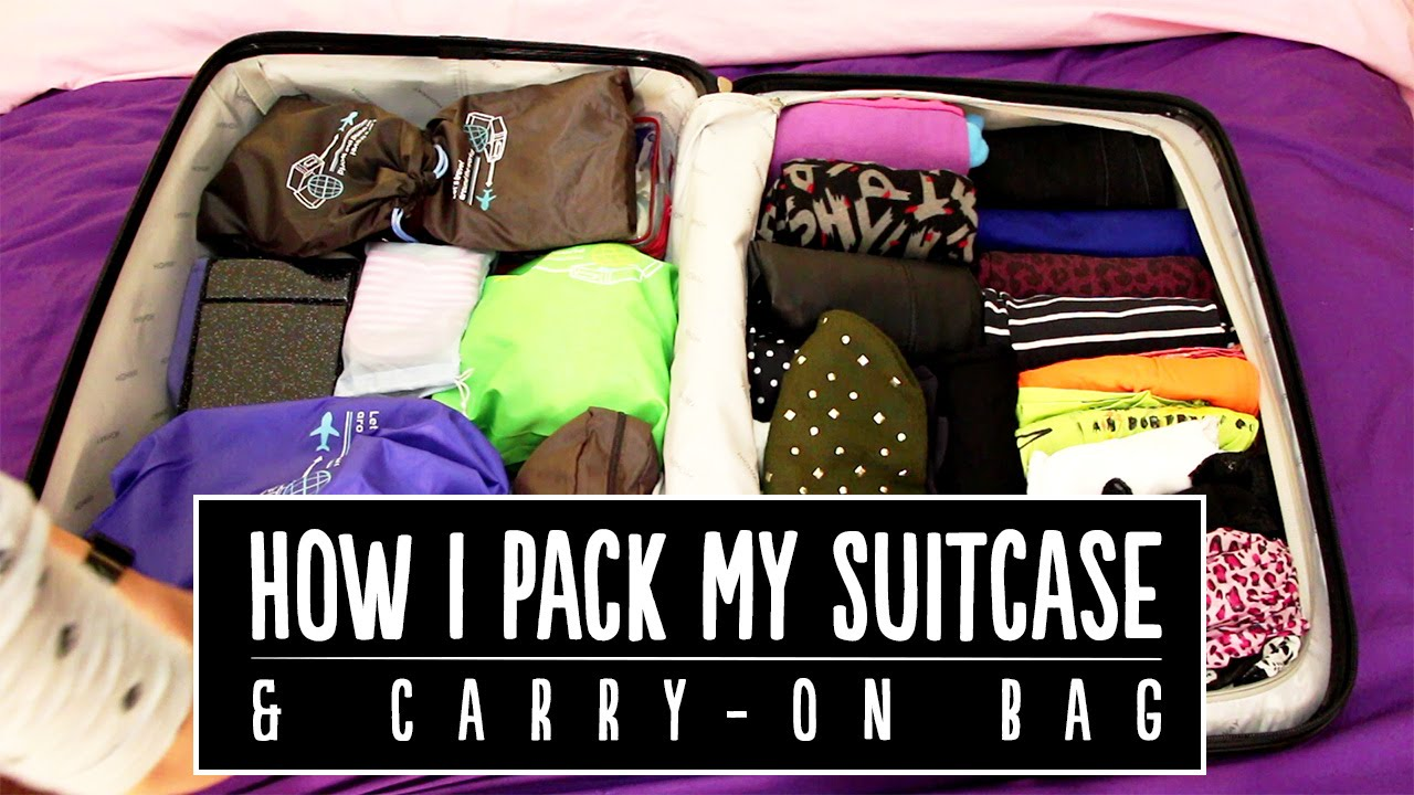 How i pack my suitcase carry on bag ootd pippopunkie How to pack a carry on suitcase video