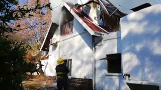 Firefighters douse the flames of the Bryanston home