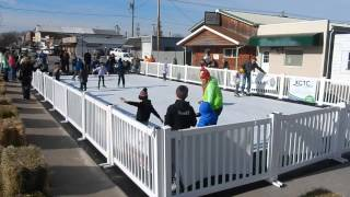 Synthetic Ice Skating Rink busy with people