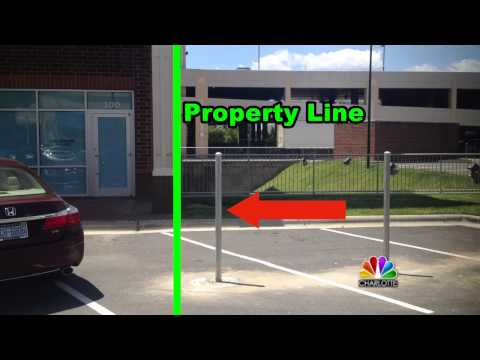 Thumbnail: In Ballantyne, metal poles are blocking open parking spaces. Why?