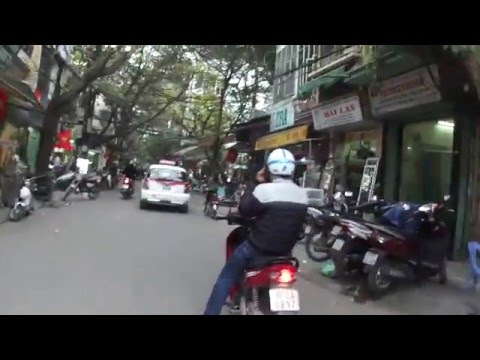 city tour of Hanoi as a passenger on a scooter