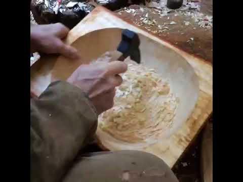 Carving a bowl an adze
