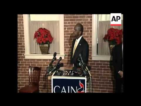 Cain discusses plans to reassess campaign, doesn't commit to any decision.