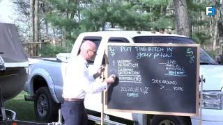 Jeff outside with chalkboard next to truck and rv