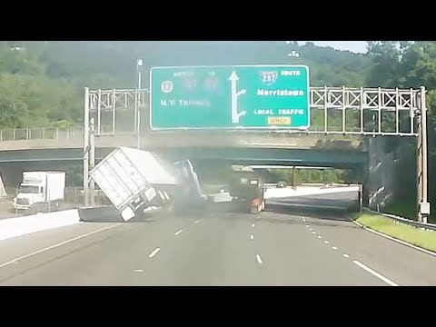 Video shows tractor-trailer overturn in alleged road rage