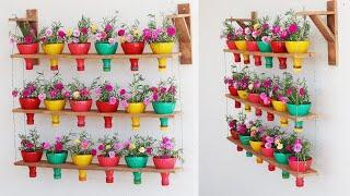 Idéias de Jardim de Parede de Garrafas Pet e Madeira Reciclada