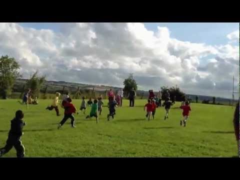 Maitiu does a Mary Decker/Zola Budd in his Junior Infants Sports Day Race