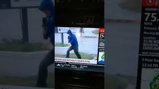 Dramatic Weather Man Bracing As Two Guys Calmly Walks By: Hurricane Florence