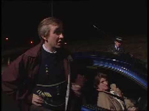 Alan Partridge steals a traffic cone.
