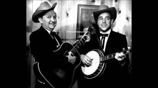 Watch Earl Scruggs Roll In My Sweet Babys Arms video
