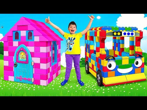 Max And Sasha Plays With Colored Toy Blocks Buses And Playhouses