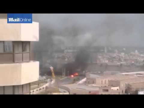 [RAW] Islamic State attack luxury Tripoli Hotel with car bomb
