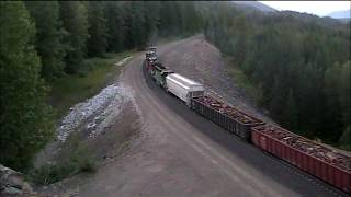 Long BNSF freight train climbs Stampede pass next to old Tunnel #2. 2008.