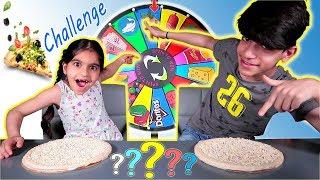 تحدي البيتزا بعجلة الحظ الغامضة بين رضا وزينب Mystery Wheel Of Pizza Challenge