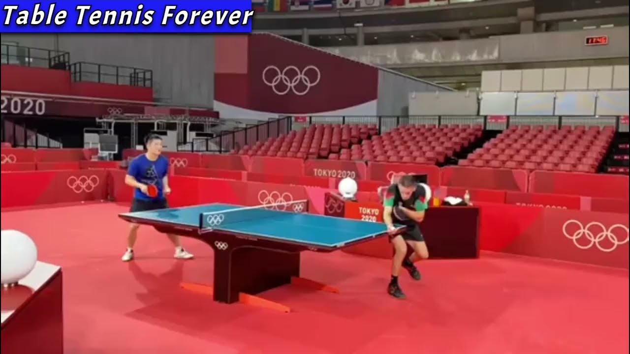 Download Fan Zhendong warming up with Marcos Freitas (Tokyo Olympics 2021)