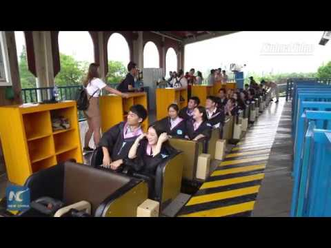 Extraordinary graduation! Chinese graduates hold roller coaster ceremony