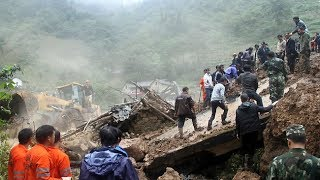 Around 100 people feared buried in China landslide: authorities