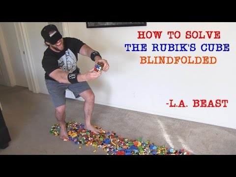 """Blindfolded Dude Solves Rubik's Cube in 3 Min (While Walking Barefoot Over LEGOS)"""