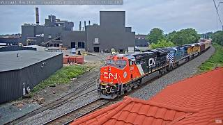 3 Colorful Engines and a pastel consist  with CN on rear. Waupaca, WI