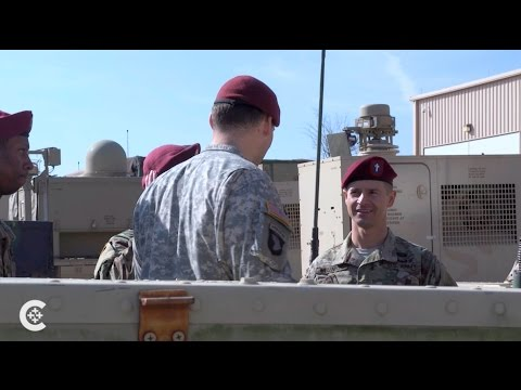 Chaplain marches with troops and inspires
