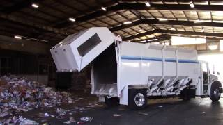 custom amrep gripper adr recycler unloading