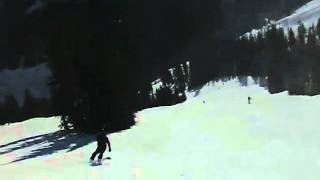 Chase camera on a carving snowboarder Thumbnail