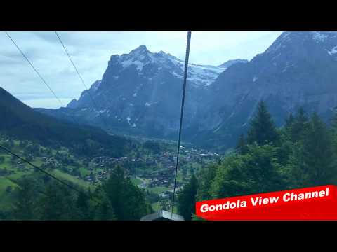 Gondola view from the longest cable car in Europe - Männlichenbahn (HD)