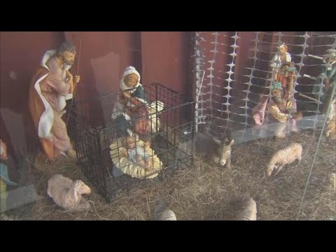 Kristina Kage - Baby Jesus in cage in Church's immigration-themed nativity scene
