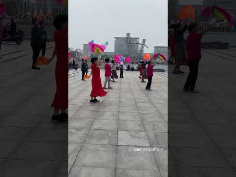 Traditional Dance by Chinese aged men and women