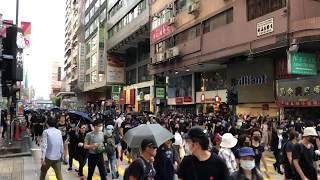 Protesters running from tear gas fired in Tsim Sha Tsui