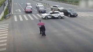 Policeman stop traffic with car to guide elderly walker
