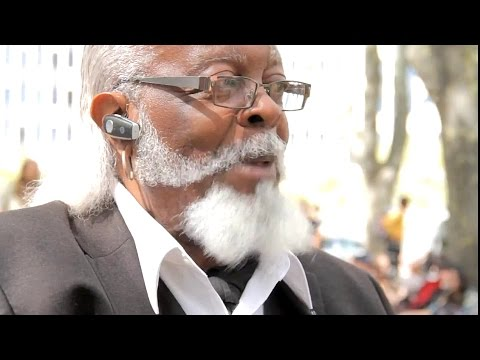 Jimmy McMillan plays hilarious song about rooster to Protester!