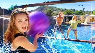 Last To Fall In The Pool Wins! HUSBAND vs. WIFE Challenge!