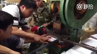PRESS WORKER GETS HIS HAND PRESSED