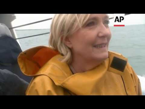 Campaigning Le Pen travels on fishing trawler