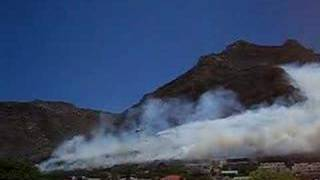 Fire fighting helicopter battles a huge mountain fire