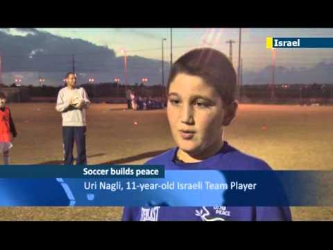 Israeli and Palestinian kids bond over soccer: football helps break through social barriers