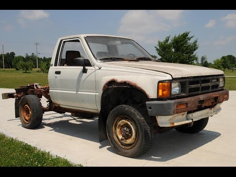 Breaking a rusty Toyota Pickup Truck frame with a hammer