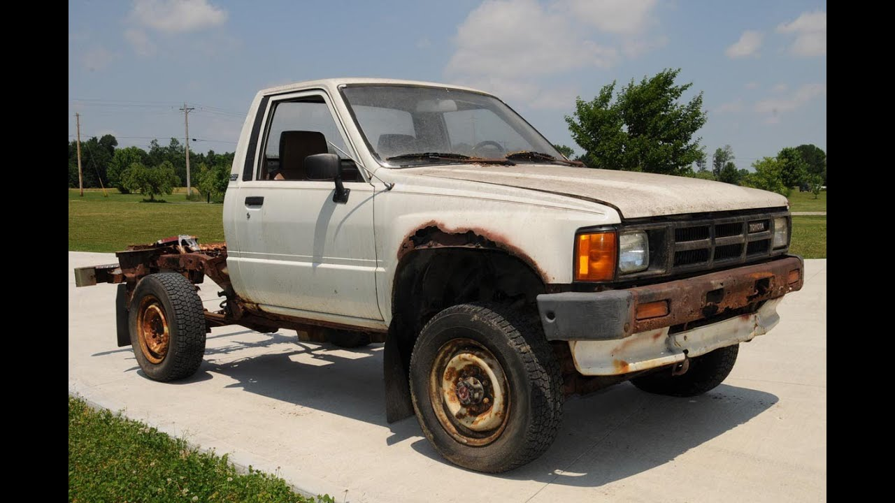 Breaking a rusty Toyota Pickup Truck frame with a hammer - YouTube