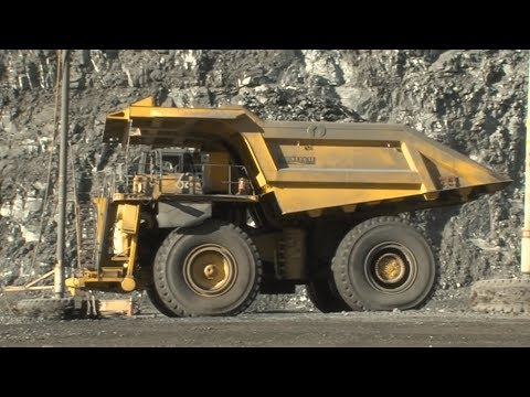 Graders And Bulldozers Smooth Gold Mine Roads For Passing Haul Trucks