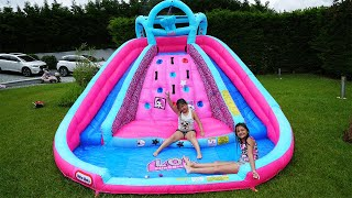 Masal and Öykü Pretend Play with Water Slide Inflatable Toys