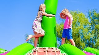 Amelia and Avelina have fun in a themepark playground using a magic portal - Tuesday compilation