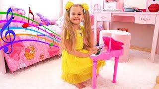 बच्चों के लिए संगीत वाद्ययंत्र के साथ डायना खेलती हैं।