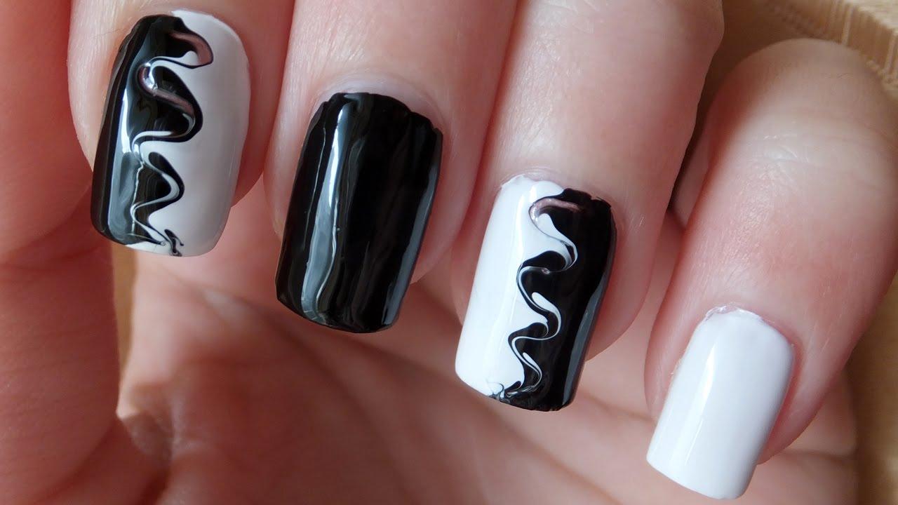 black and white swirl nail art