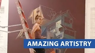 Woman Paints Mural Of Abstract House