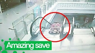 Man Rescues Infant Falling Down Escalator on Stroller