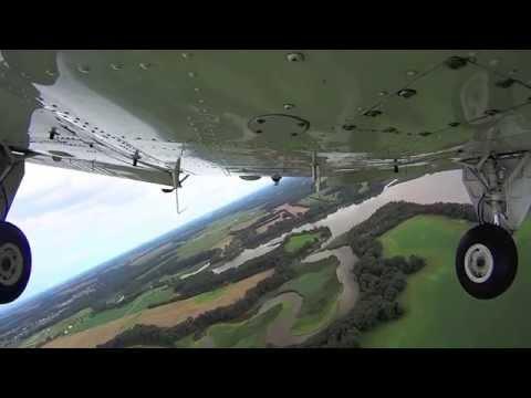 Beechcraft Baron landing on grass