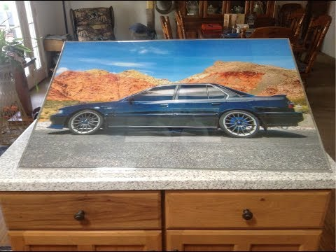 DIY FREE 24x36' poster from ShutterFly or other 4x6' prints photo printing services.