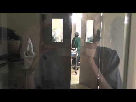 Watching surgery through double doors in Jinja hospital, Africa