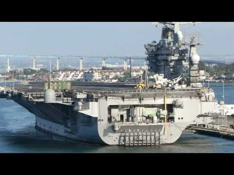 July 23, 2010 - USS Abraham Lincoln passes USS Nimitz while pulling out of San Diego for COMPTUEX
